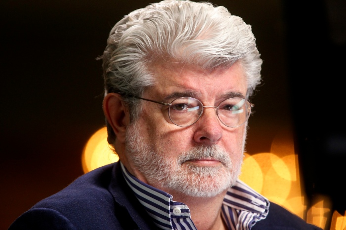 Filmmaker and Chairman of the Board of Lucasfilm Ltd. George Lucas waits to do a television interview in Beverly Hills
